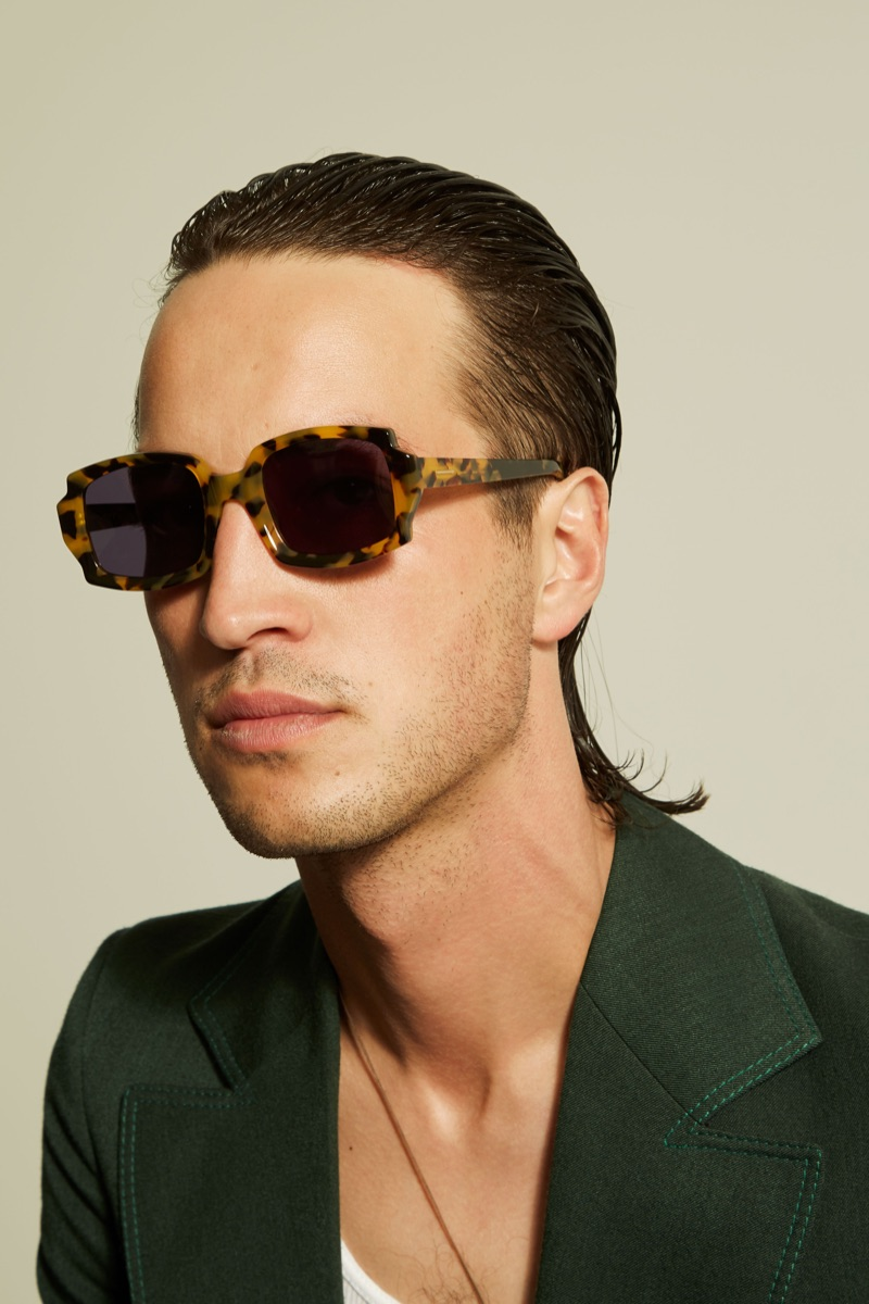 Singer-songwriter Marlon Williams is a cool vision in Karen Walker's McQueen sunglasses from the brand's Monumental collection.