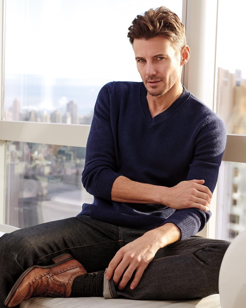 Relaxing, Alex Lundqvist wears a v-neck sweater by Naked Cashmere.