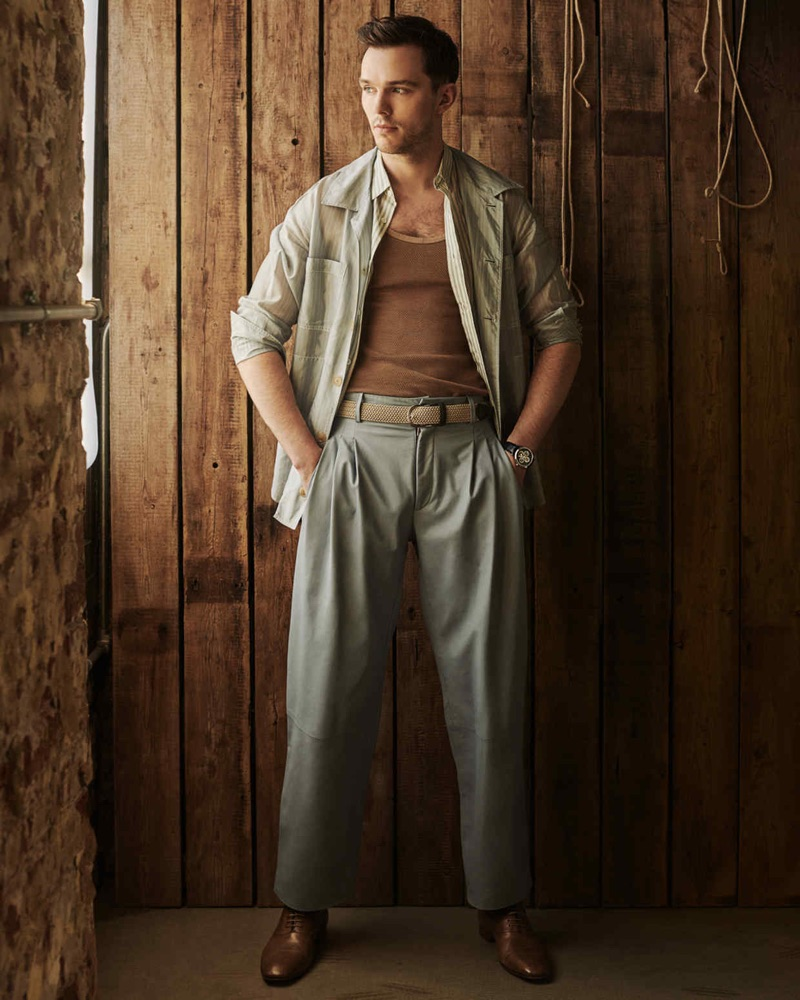 Actor Nicholas Hoult sports a Dior Men shirt, leather Paul Smith trousers, Christian Louboutin shoes, and an Anderson's belt.