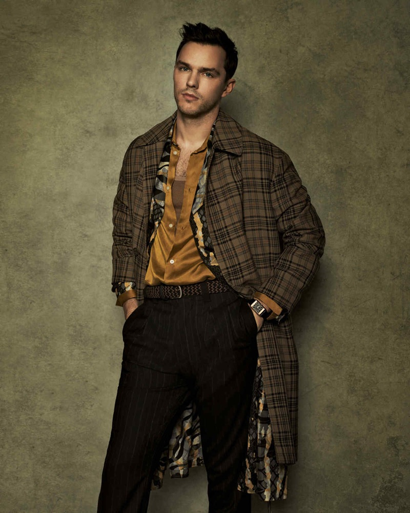 Front and center, Nicholas Hoult sports a check Hermès coat over a Roberto Cavalli coat. The actor also dons a Sean Suen shirt and Margaret Howell trousers with an Anderson's belt.