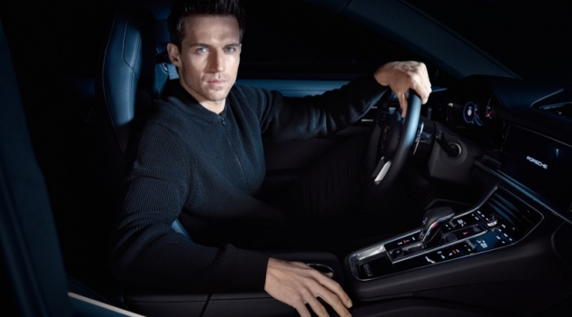 Getting behind the wheels of a Porsche, Andrew Cooper wears an all-black look from the brand's BOSS capsule collection.