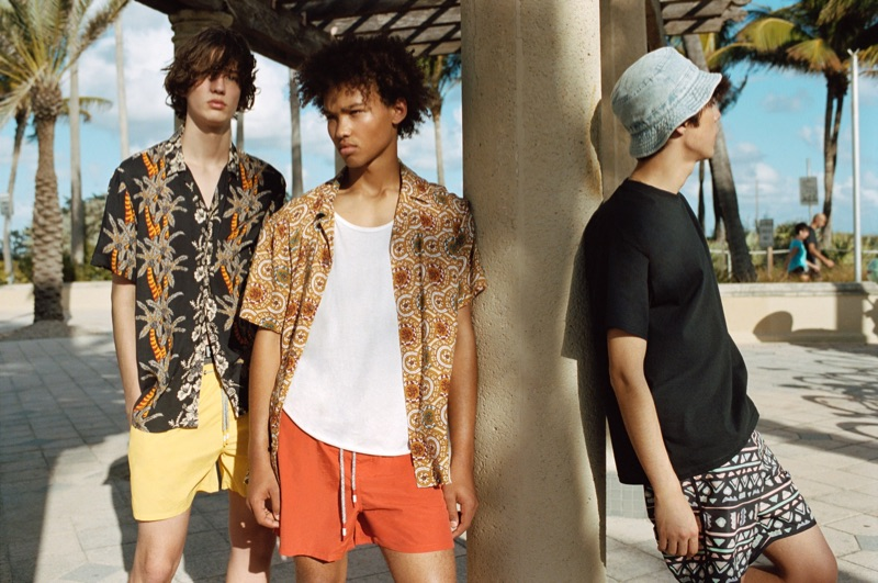Niks Gerbasevskis, Miles Anderson, and Claude Morgan sport swimwear and printed shirts from Pull & Bear.