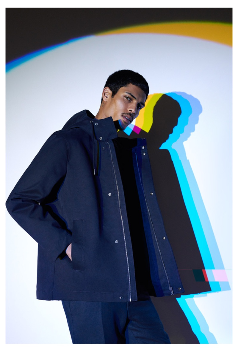 Sporting a navy parka, Geron McKinley models Reserved.