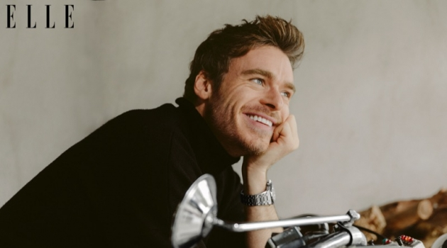 All smiles, Richard Madden connects with Elle magazine for a feature.