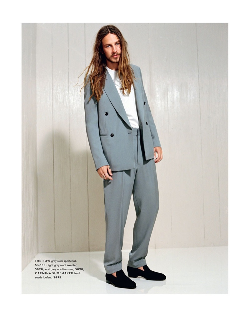 Front and center, Riley Hawk dons a double-breasted jacket, trousers, and sweater by The Row. He also wears suede loafers from Carmina Shoemaker.