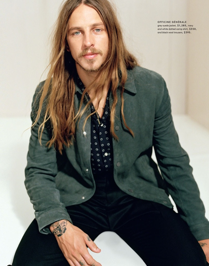 Riley Hawk wears a suede jacket, camp shirt, and wool trousers by Officine Generale.