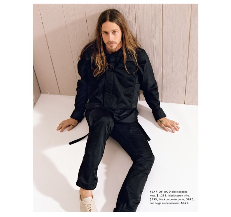 Skater Riley Hawk wears a padded vest, shirt, carpenter pants, and sneakers by Fear of God.