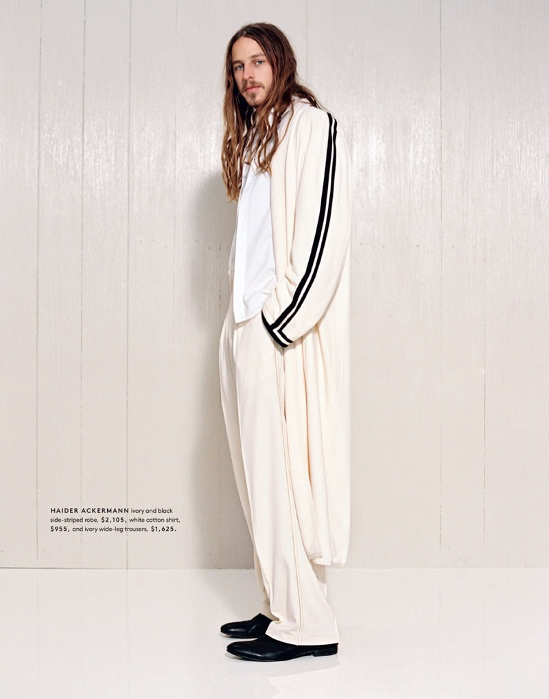 Embracing neutrals, Riley Hawk sports a side-striped robe, shirt, and wide-leg trousers from Haider Ackermann.