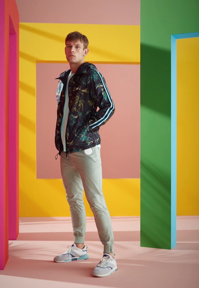 Going sporty, Elliott Reeder wears a Scotch & Soda palm pattern jacket, solid t-shirt, and sweatpants.