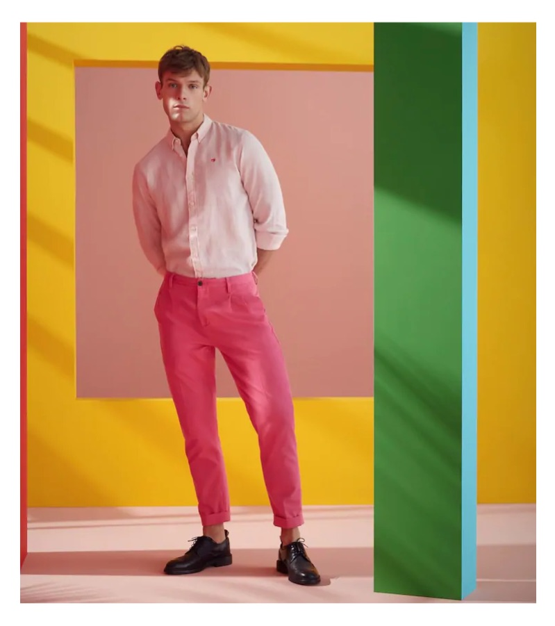 Embracing pink, Elliott Reeder sports a Scotch & Soda shirt and loose tapered fit trousers.