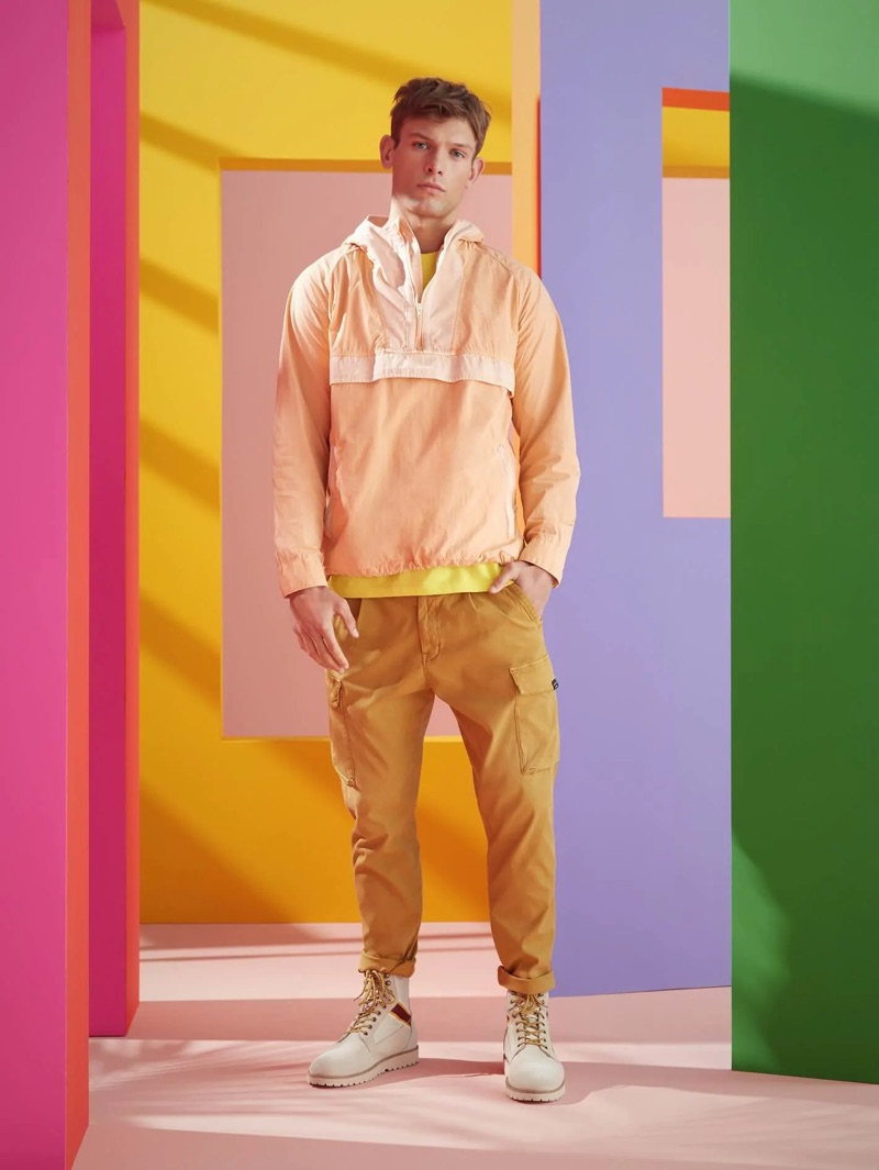 Sporting summer hues, Elliott Reeder wears a Scotch & Soda summer anorak and washed combat trousers.