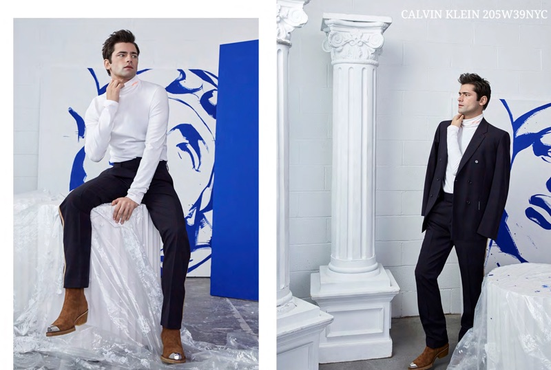 Wearing black and white, Sean O'Pry sports streamlined pieces by Calvin Klein 205W39NYC.