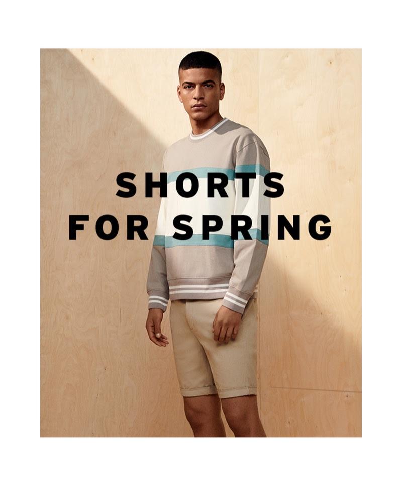 Zakaria Khiare sports a Topman paneled sweatshirt with a pair of shorts.