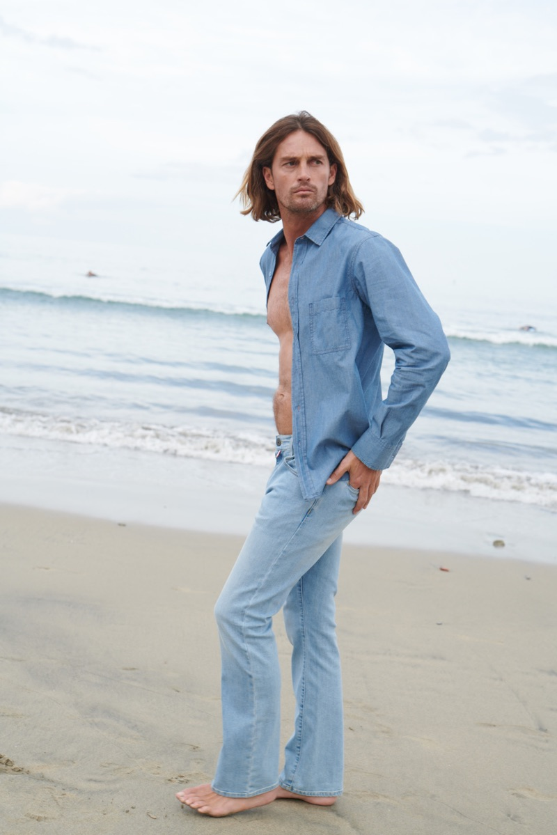 d4ded7c1670 Ryan Heavyside wears a cotton shirt and men 70s flare jeans from Vilebrequin .
