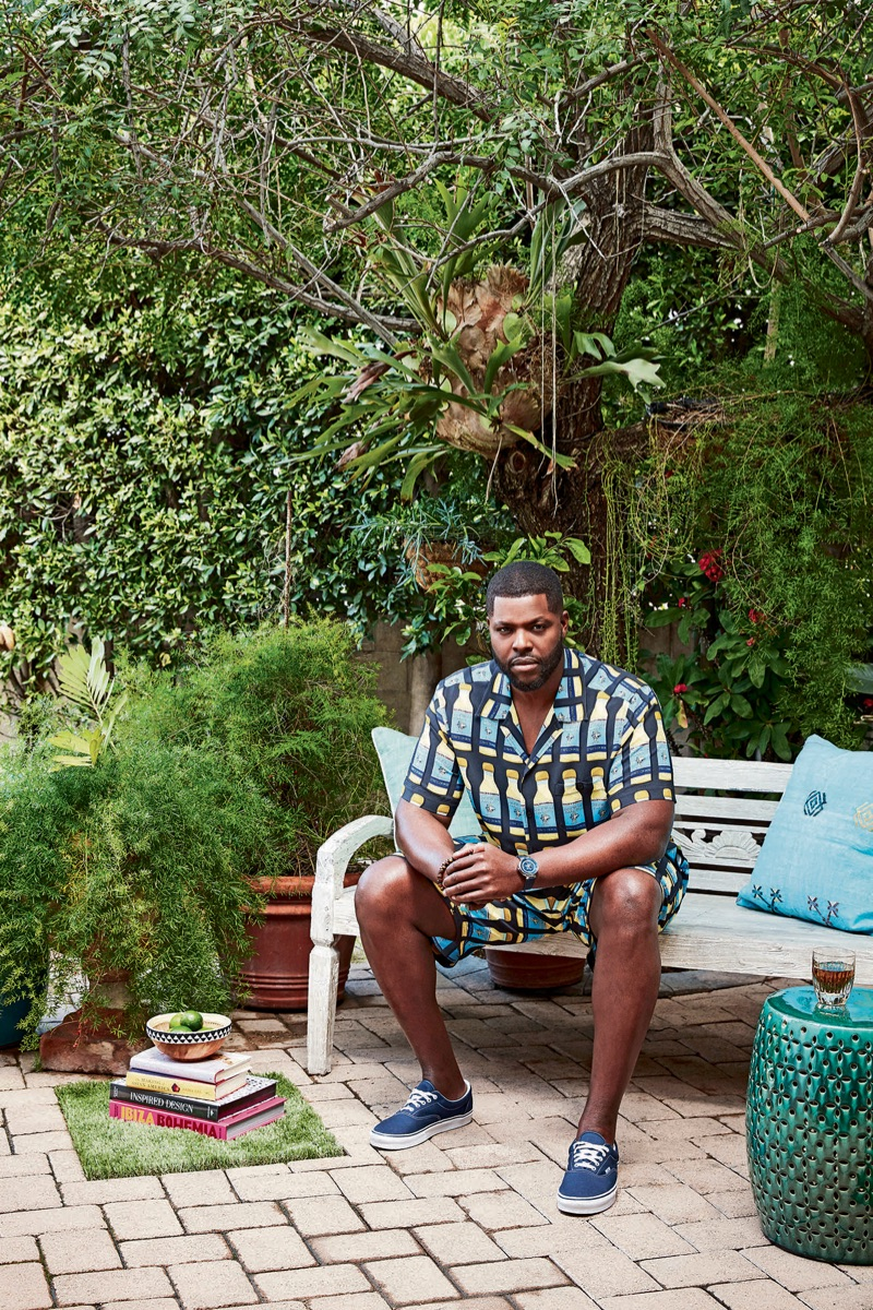 Actor Winston Duke sports a Dolce & Gabbana shirt and shorts with Vans sneakers. He also dons a Louis Vuitton watch and David Yurman bracelet.