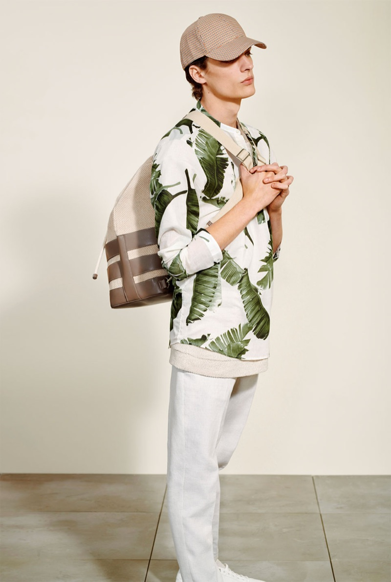 Making a statement, Valentin Caron dons a botanical print from Zara Man.