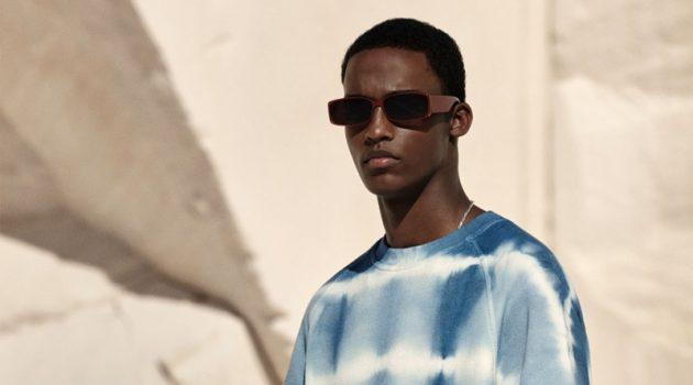 Mahad Musse dons a tie-dye short-sleeve sweatshirt from Zara.