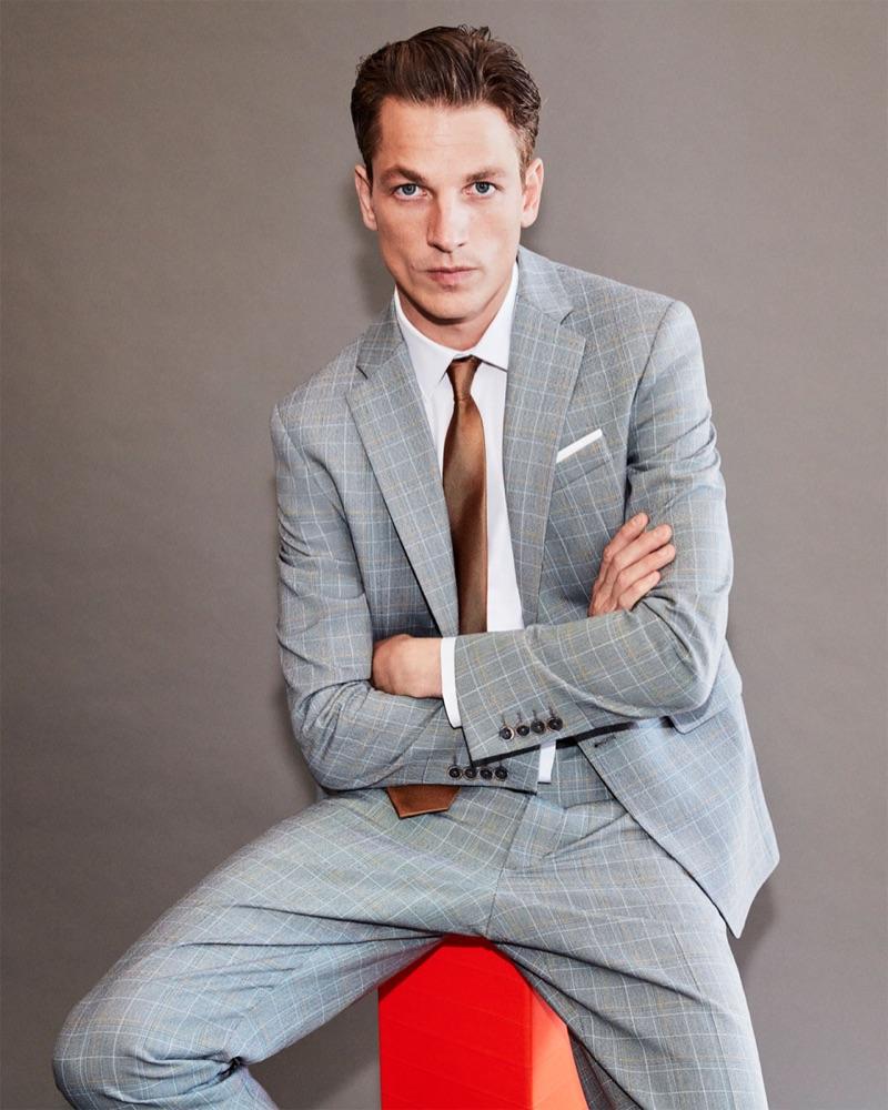 Hugo Sauzay don a grey checked suit by Zara Man.