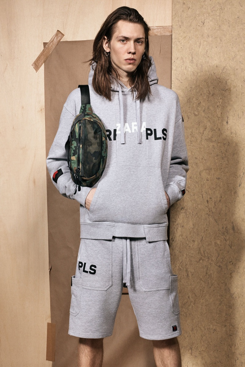 Going sporty, Sebastian Åhman wears a grey hoodie and sweat shorts from the Zara SRPLS collection.