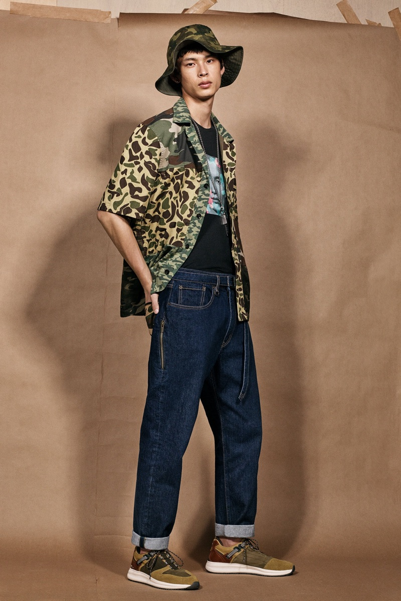 Yang Hao sports blue jeans and a camouflage shirt with bucket hat from the Zara SRPLS collection.