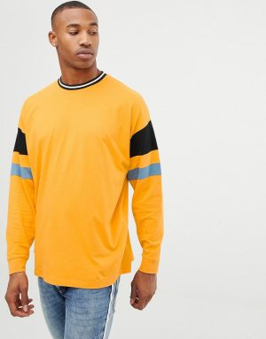 ASOS DESIGN oversized longline long sleeve t-shirt with color blocking in yellow - Yellow