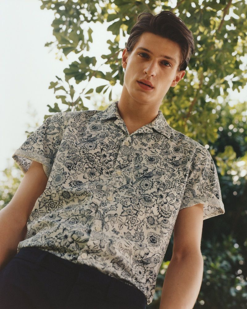 Sporting a printed shirt, Edoardo Sebastianelli appears in Arket's spring-summer 2019 campaign.