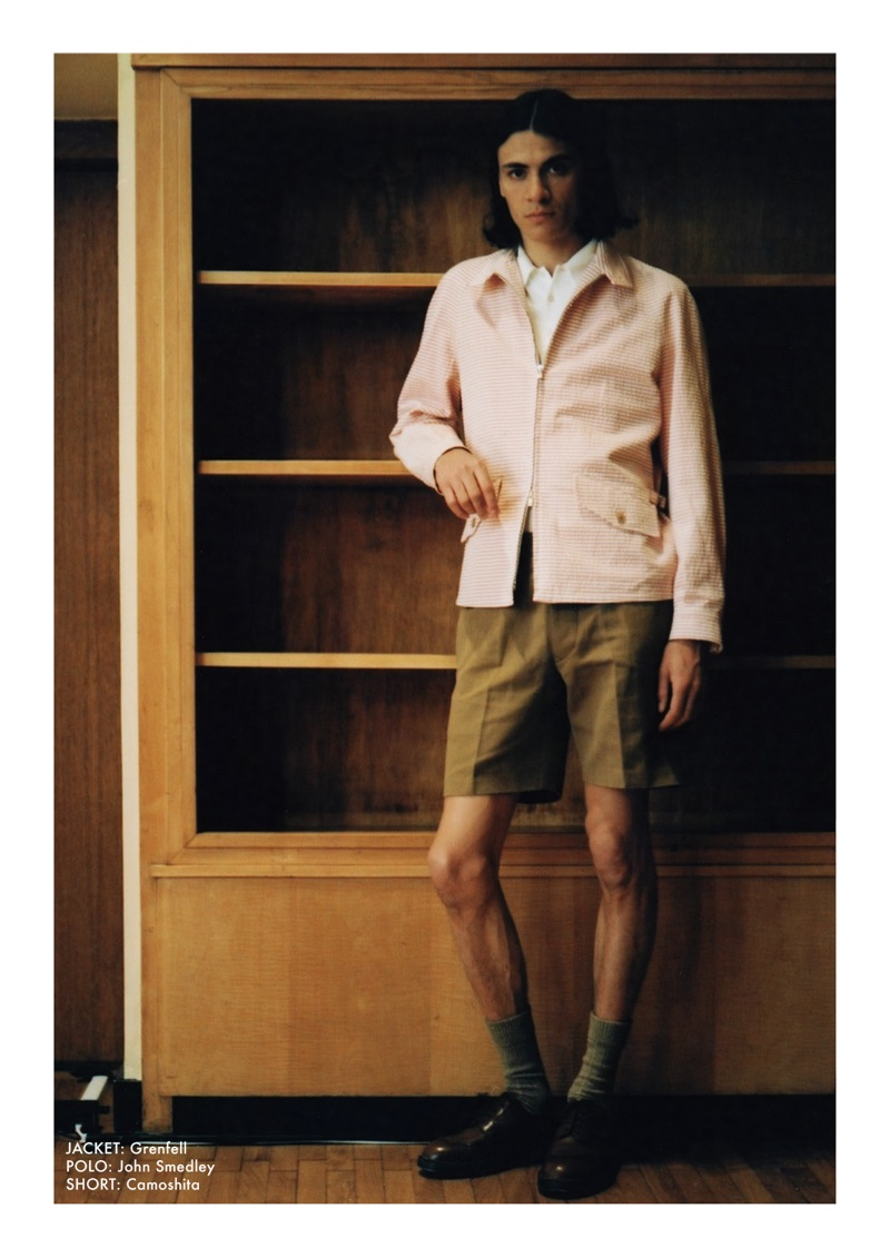 Embracing spring style, Coco Roussel sports a Grenfell jacket, John Smedley polo, and Camoshita shorts.