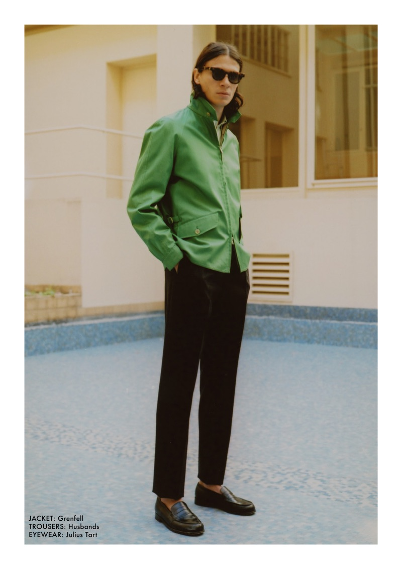Showcasing an easy cool, Coco Roussel dons a Grenfell jacket, Husbands trousers, and Julius Tart sunglasses.