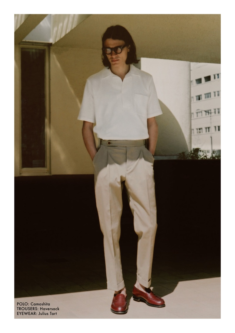 Wearing Julius Tart glasses, Coco Roussel sports a Camoshita polo and Haversack trousers.