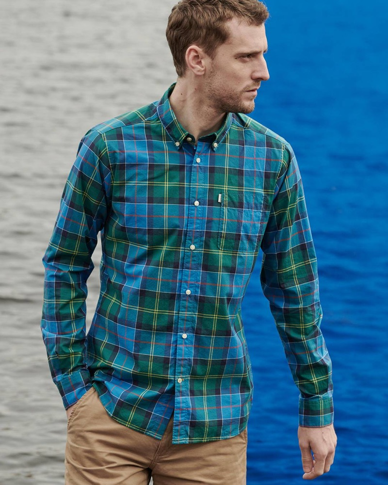 Reuniting with Barbour, George Barnett sports a blue and green shirt from the brand's spring-summer 2019 Pop Tartan collection.