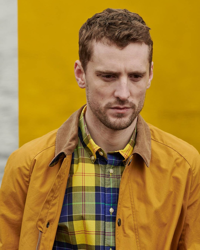 British model George Barnett dons a blue and yellow shirt from Barbour's Pop Tartan collection.
