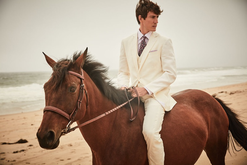 Riding a horse, Oriol Elcacho appears in Brooks Brothers' summer 2019 campaign.