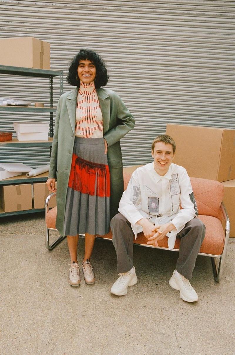 All smiles, Michael Sharp sports a Yohji Yamamoto shirt, Kiko Kostadinov trousers, and Gucci sneakers.