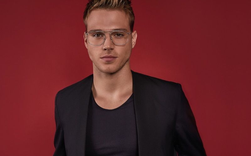 Donning glasses, Matthew Noszka appears in Carrera's spring-summer 2019 eyewear campaign.
