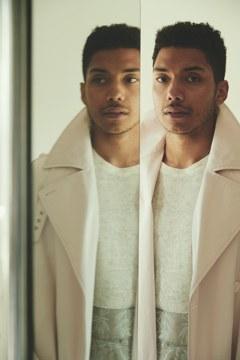 Front and center, Chance Perdomo sports a Hugo Boss trench coat with a sweater and pants by Etro.