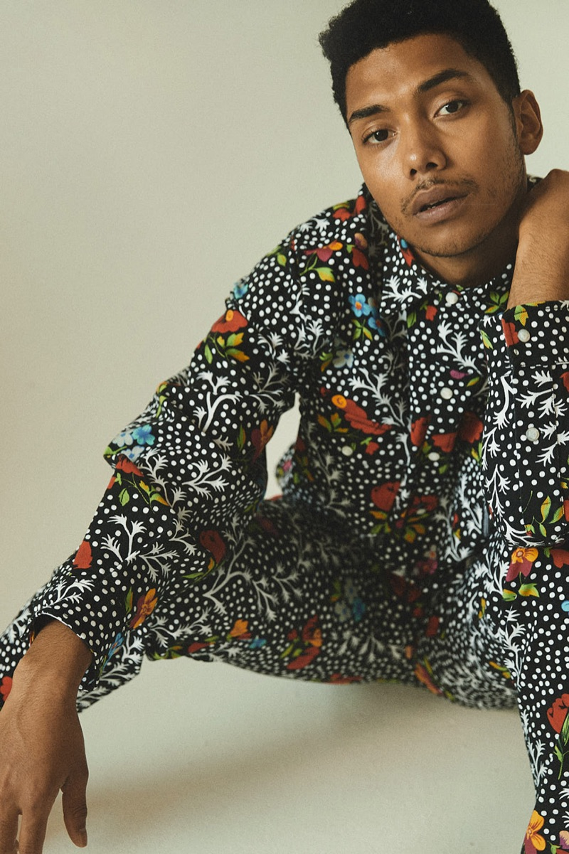 Embracing an all-over print, Chance Perdomo dons an outfit by Versace.