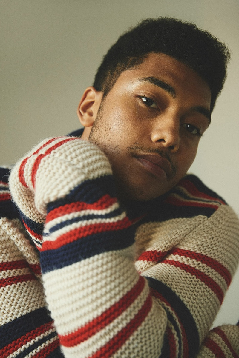 Chance Perdomo wears a striped sweater by Gucci.
