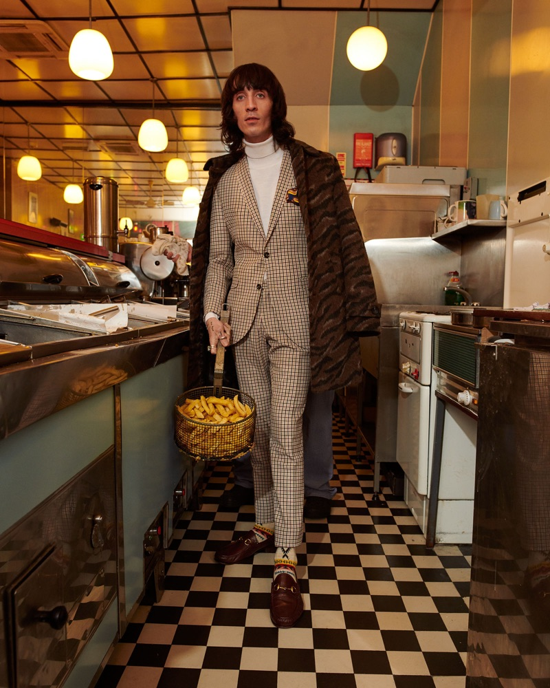 Carrying a basket of fries, Juan Milan stars in Club of Gents' fall-winter 2019 campaign.