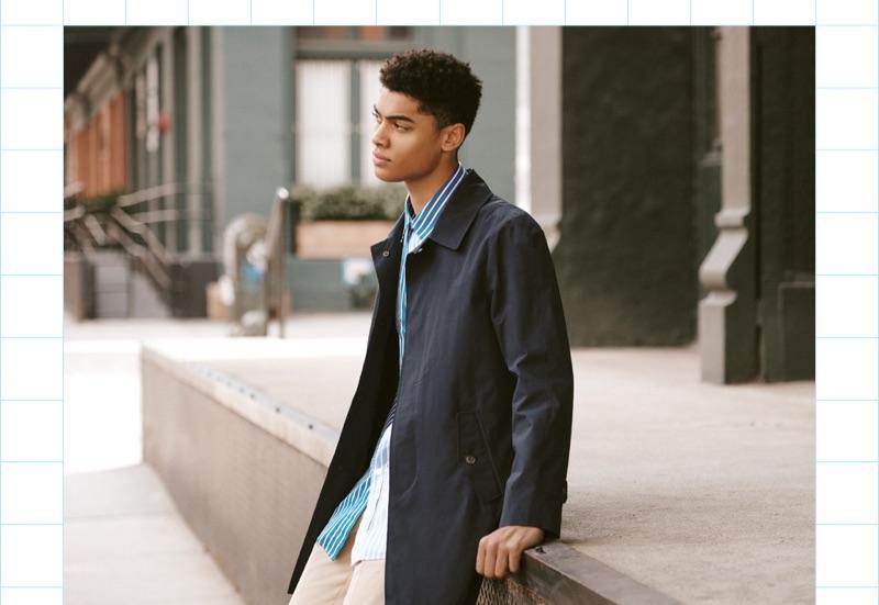 Model Désiré Mia sports a Baracuta G10 jacket, AMI pants, and a Kenzo short-sleeve shirt.