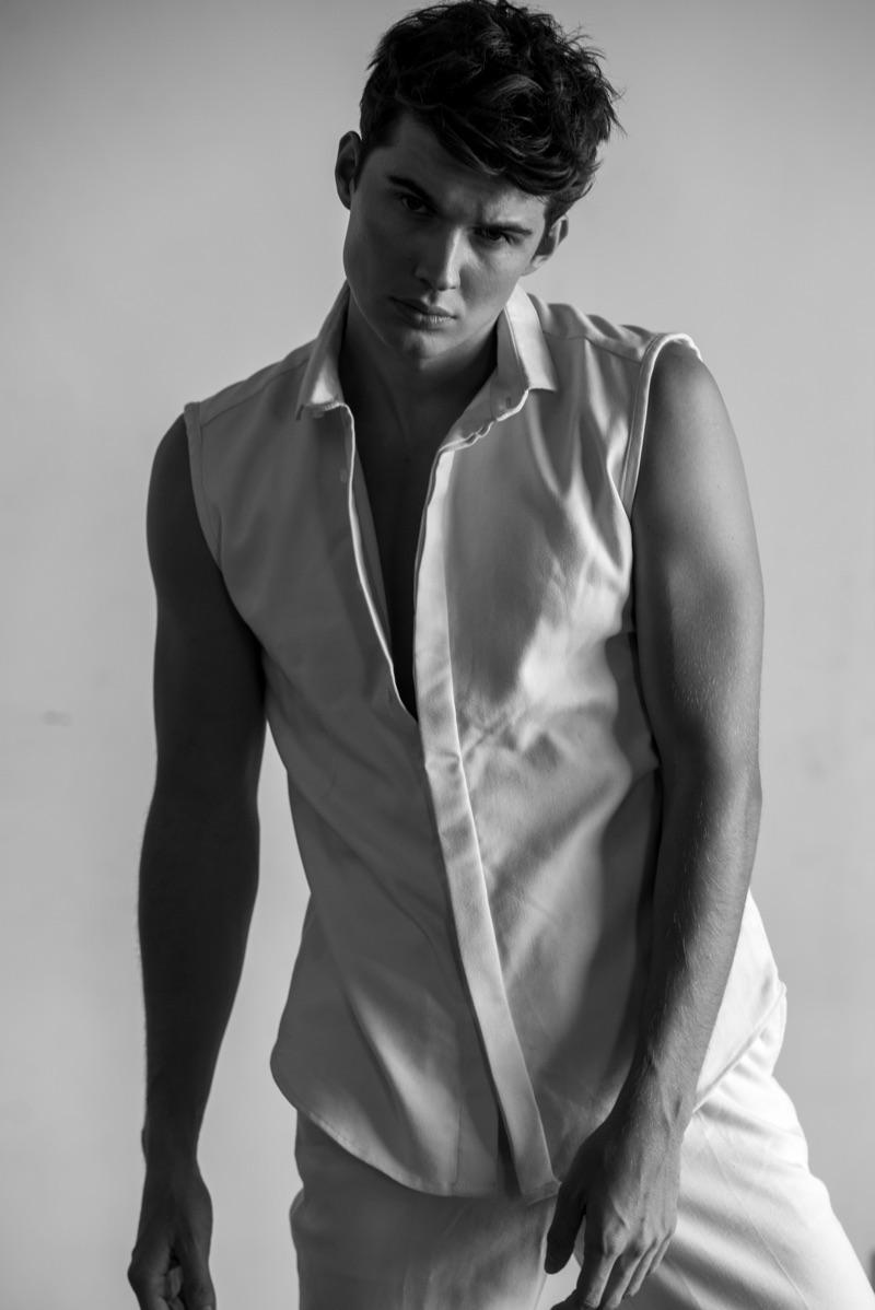 Lukas wears sleeveless shirt and pants Chris Diaz.