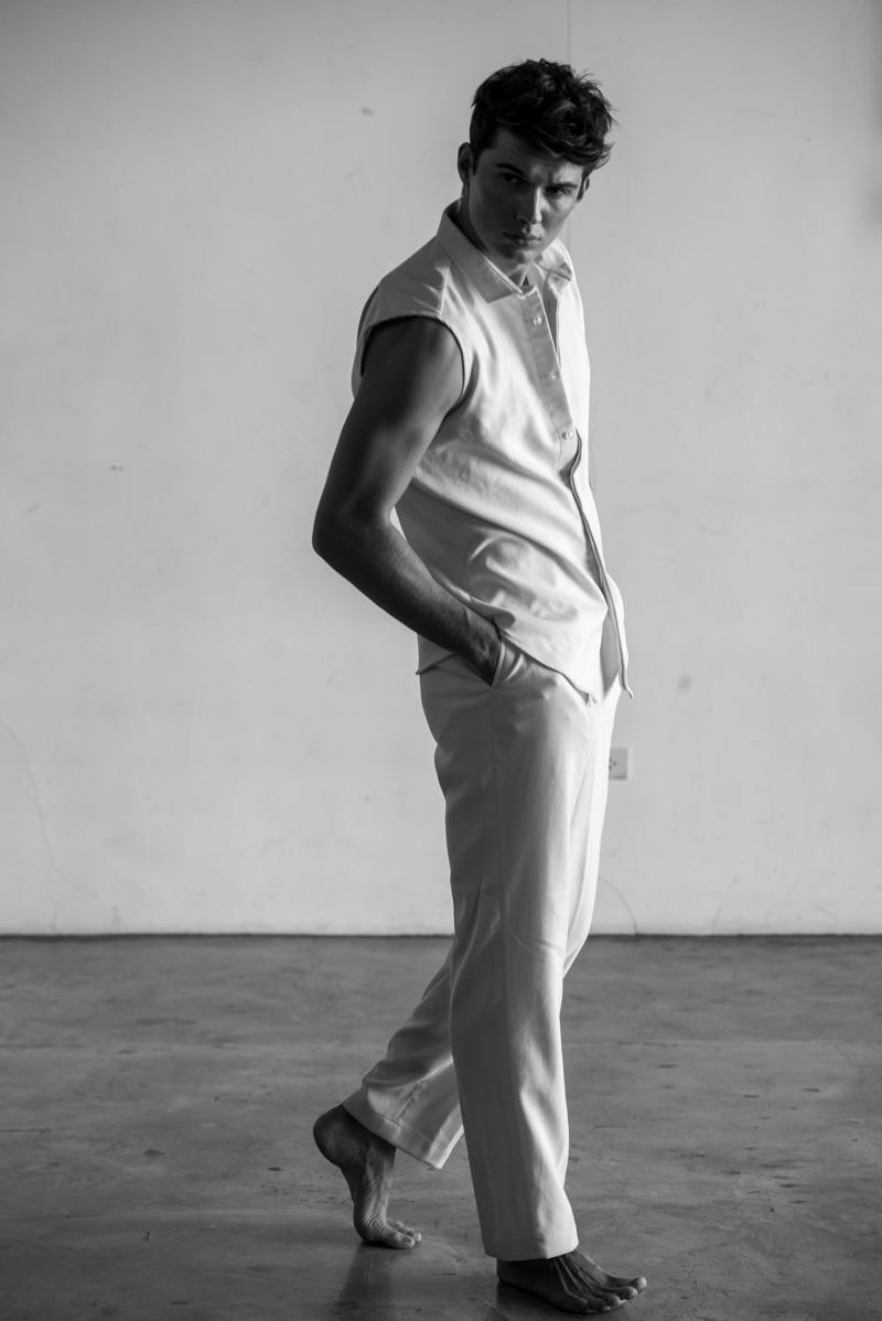 Lukas wears pants and sleeveless shirt Chris Diaz.