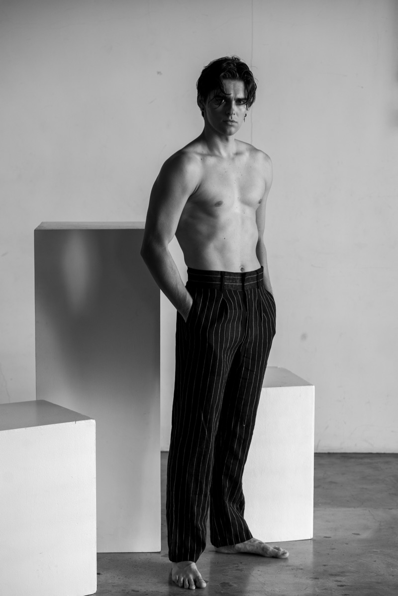 Jakub wears striped trousers Chris Diaz.