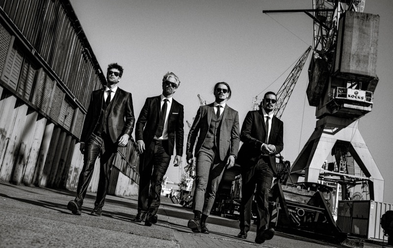 Left to Right: Julian wears suit Dolce & Gabbana and shirt Seidensticker. Soehnke wears suit The Kooples and shirt BOSS. Ric wears suit Selected Homme and shirt Suitsupply. Chris wears suit Drykorn and shirt Angelo Litrico.