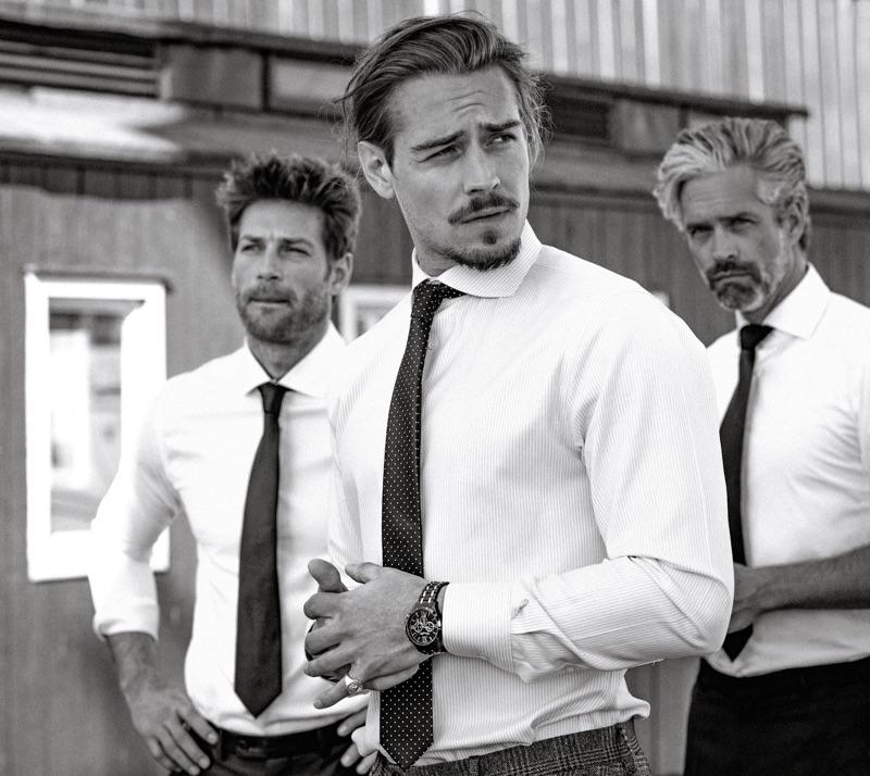Left to Right: Julian wears shirt Seidensticker. Ric wears shirt Suitsupply and ring Thomas Sabo. Soehnke wears shirt BOSS.