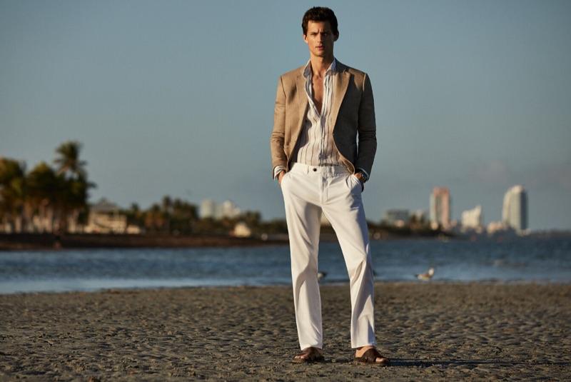 Taking to the beach, Garrett Neff models a chic summer look by Pedro del Hierro.
