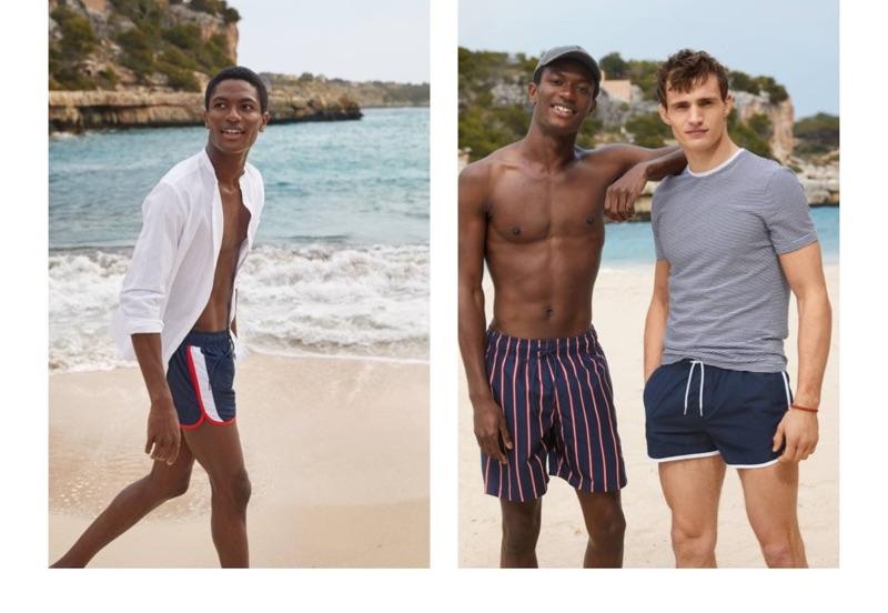 Models Hamid Onifade and Julian Schneyder sport swimwear from H&M.