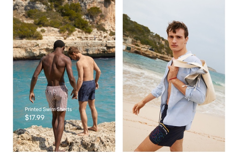 Taking to the beach, Hamid Onifade and Julian Schneyder wear H&M swim shorts.