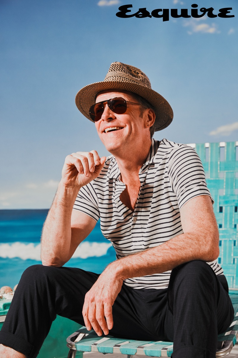 Iain Glen dons a Scotch & Soda hat and Dolce & Gabbana sunglasses with a shirt and trousers by Dondup.