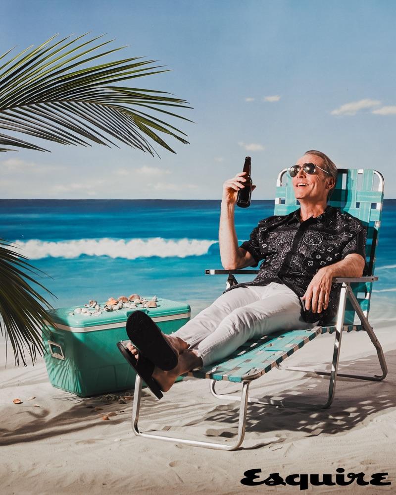 Actor John Bradley sports Dolce & Gabbana sunglasses, an Alexander Wang shirt, POLO Ralph Lauren jeans, and Le Tigre sandals.