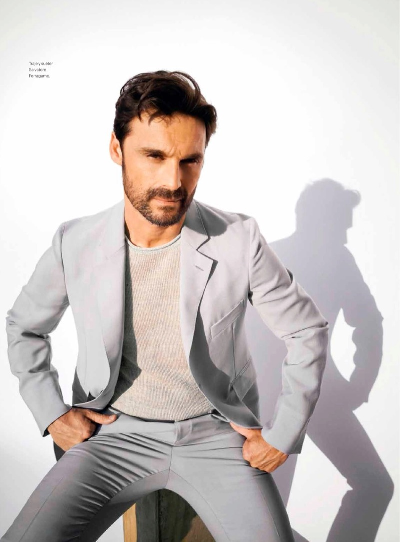 Embracing shades of grey, Iván Sánchez wears a sweater and suit from Salvatore Ferragamo.
